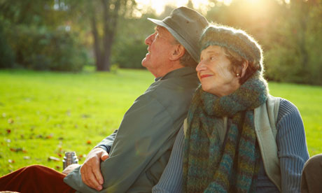 An older couple sitting in a park