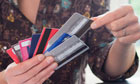 A woman with an array of credit cards