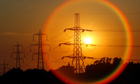 The sun sets behind pylons in central England