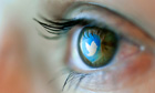 The Twitter logo reflected in an eye