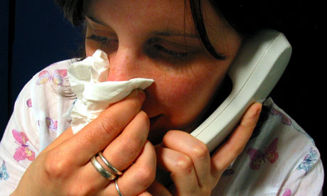 A woman phoning in sick to work