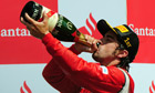 Fernando Alonso celebrates winning the F1 Santander British Grand Prix
