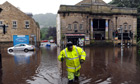 Hebden Bridge hit by floodwaters that surround its cinema and local shops