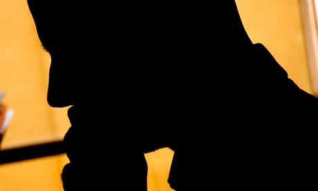 Silhouette of a person on the telephone at work