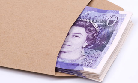 Stack of British money inside a brown envelope