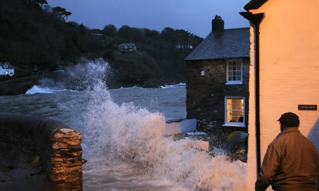 A holiday cottage takes the full force of a wave at Lee near Ilfracombe, North Devon