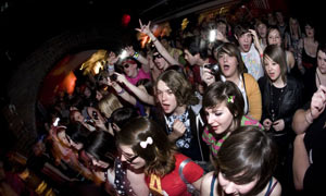 Fans cheer as AlphaBeat perform live during the Wonky Pop tour in Cardiff, Wales