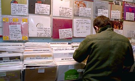 Man searches through racks of vinyl at a record shop