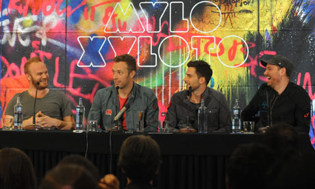 Crossing the stream … Coldplay at a press conference promoting Mylo Xyloto on Wednesday 26 October.