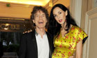 Sir Mick Jagger, pictured with partner L'Wren Scott, has taken a fusion approach with his new group