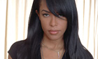 Aaliyah poses with hair over one eye