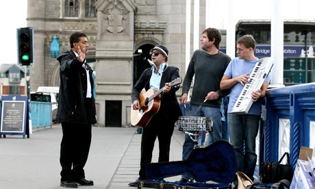 The Silver Seas busk on Tower Bridge - an official waves them on