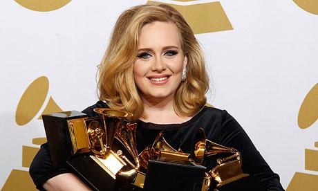 Adele holding her six Grammy awards