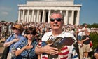 People listen to the national anthem at