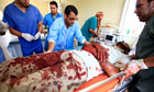 Libyan medics treat an injured rebel fighter