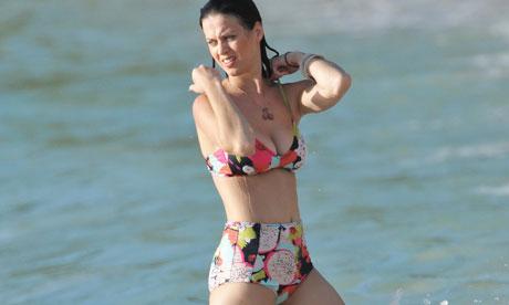 Singer Katy Perry sets the trend with a high-waist bikini.