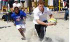 Britain's Prince Harry plays beach rugby on Flamengo Beach in Rio De Janeiro