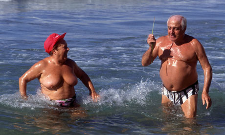 happy overweight people in sea