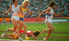 US runner Mary Decker plunges to the infield grass after a collision with Britain's Zola Budd, right