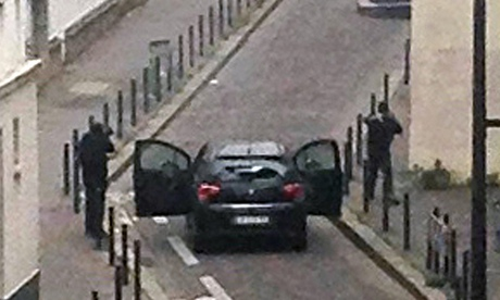The Charlie Hebdo gunmen in the street.