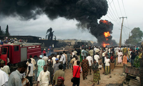 A ruptured pipeline burns in a Lagos suburb after an explosion in 2008 which killed at least 100 people.