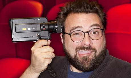 Kevin Smith holding camera