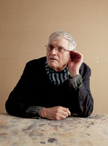 David Hockney cupping his ear