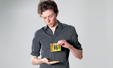 Tom Lamont holding Spice packet