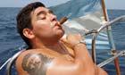 Maradona smoking a cigar