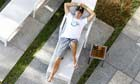 Jenson Button relaxes on a sunlounger