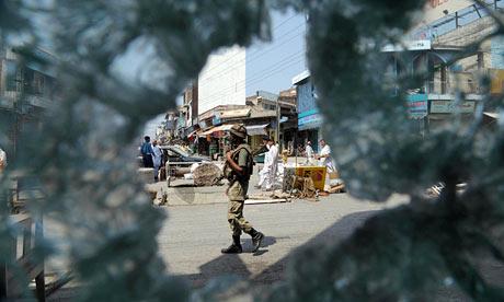 A Pakistani soldier patrols Mingora