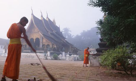 Monks perform daily chores in Luang Prabang.