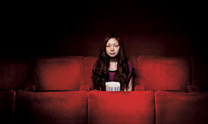 girl alone in cinema