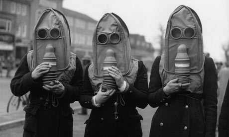 Three air raid wardens wearing gas masks Three air raid wardens wearing a