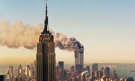 smoke pours from the Twin Towers
