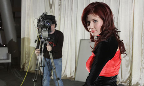 "State secret: among her many new roles, Chapman now presents a weekly ""investigative"" TV show called Mysteries of the World with Anna Chapman."