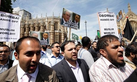 Protesters from Hizb ut-Tahrir demonstrate outside parliament