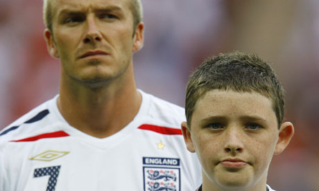 Former England mascot Robert Sebbage with David Beckham at Wembley in 2007