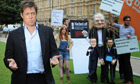 Hugh Grant outside Parliament during protest against phone hacking