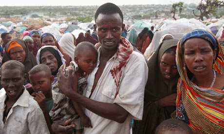 A male binds his three-year-old daughter during a stay for replaced persons in Mogadishu. Getty photo