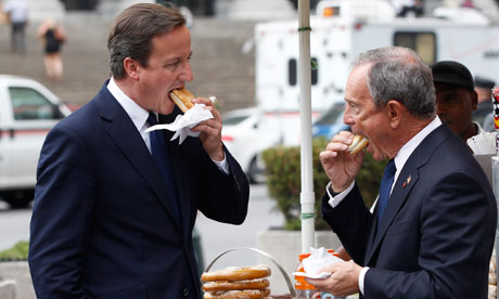 British PM Cameron eats a hot dog with New York City Mayor Bloomberg in New York
