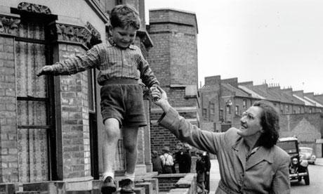 1950s England: a boy walks on a wall