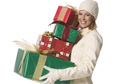 woman in hat holding christmas gifts