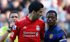 Liverpool's Suarez looking at Manchester United's Evraield in Liverpool