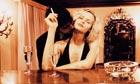 Man Kissing Woman at Bar