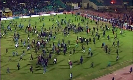 Fans rush the pitch during the riots that erupted after the match between Al-Masry and Al-Ahl