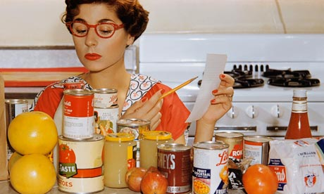 Woman in Kitchen Checking Groceries
