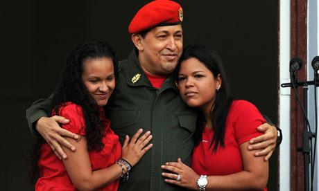 Venezuelan President Hugo Chavez (C) emb