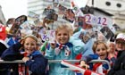 Children wave and cheer at Team GB parade