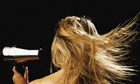 Teenage girl (16-18) blowdrying hair